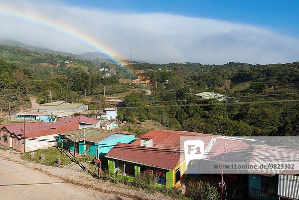 Costa Rica. Montverde  rainbow over town