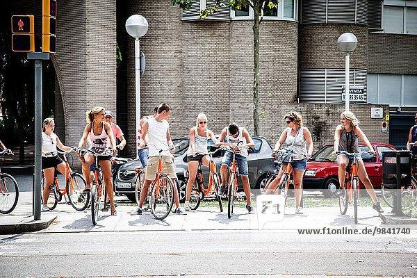 Tourists riding bikes in Villa olimpica  Barcelona.