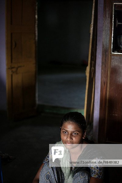 Girl at her home in India.