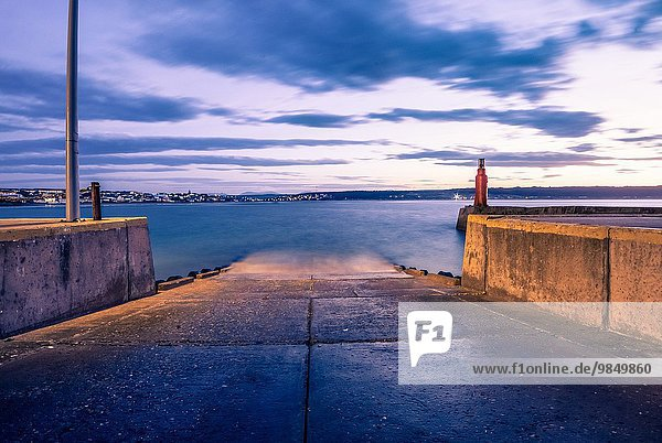 The beacon on the harbour wall. An empty slipway before the early morning boats start launching to go fishing. Still Bay  South Africa