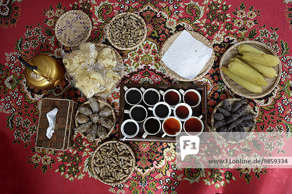Local food  tea and coffee on a red carpet  Gampong Nusa  Aceh  Indonesia  Asia