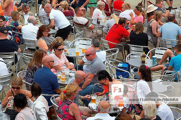 People sat enjoying food and drink outside at the Cardiff bay festival  Wales  UK.