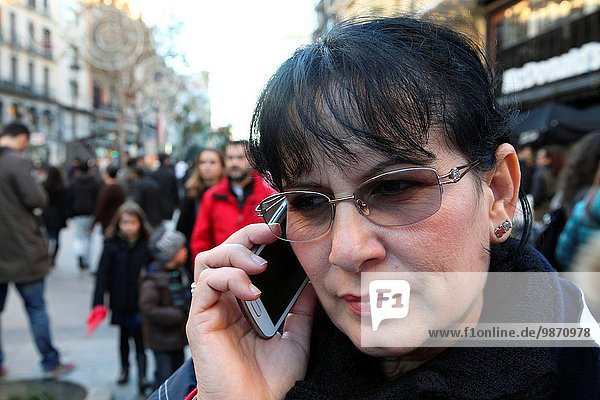 Woman talking on mobile phone on a street in Madrid  Spain  Europe