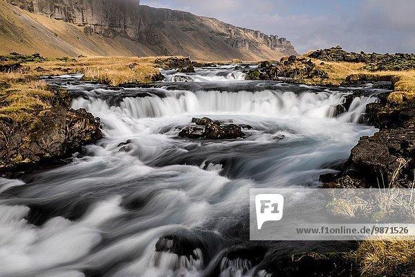 Autumn waterfall  Iceland.