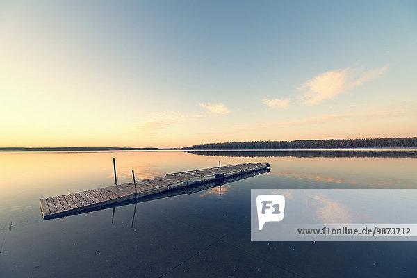 Wasser Sonnenuntergang Ruhe fließen See flach