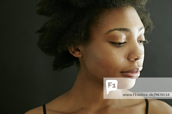 Close up of smiling black woman looking down