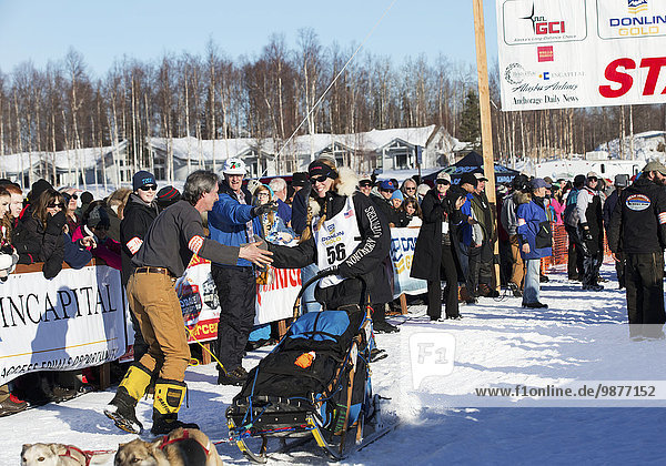 Kristy Berington heads down the chute during the restart of the 2014 Iditarod  Willow  Southcentral Alaska
