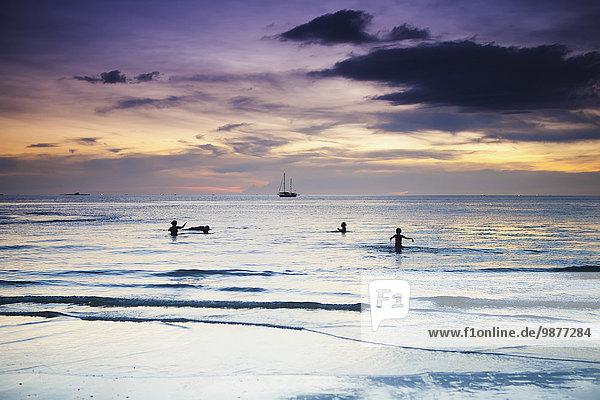 Strand Sonnenuntergang Ozean schwimmen