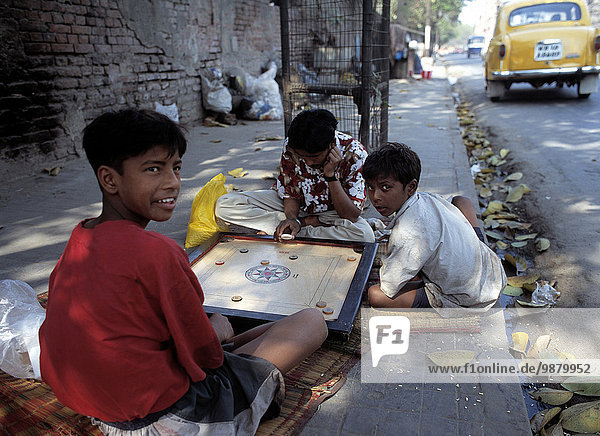 Children Playing Games On Street  Calcutta  West Bengal  India.