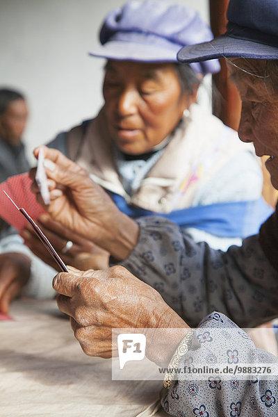 Frau Spiel chinesisch Karte Lijiang