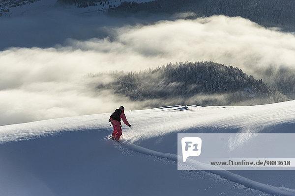 Snowboarding Wolke über Kanton Graubünden