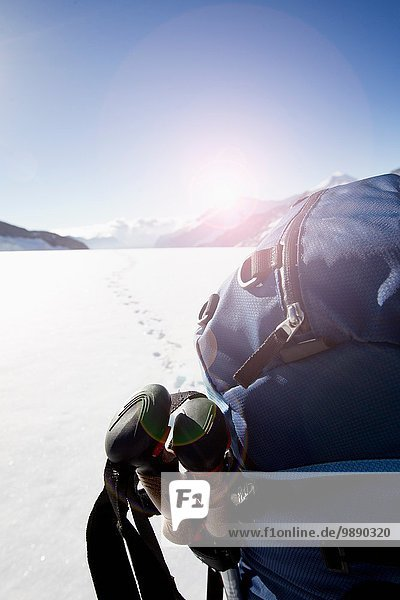 Rear view of male hikers backpack in snow covered landscape  Jungfrauchjoch  Grindelwald  Switzerland