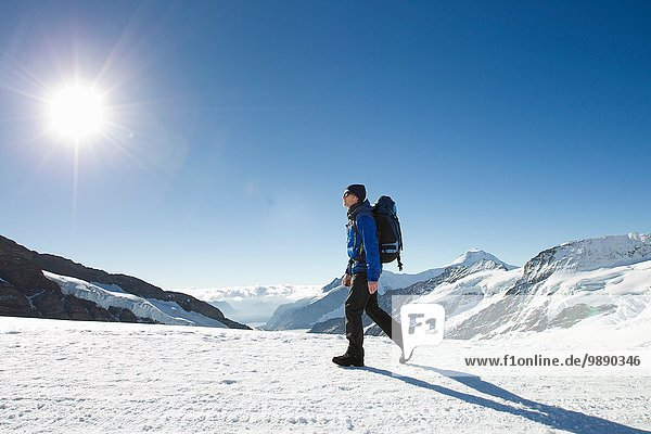 Man hiking in snow covered mountain landscape  Jungfrauchjoch  Grindelwald  Switzerland