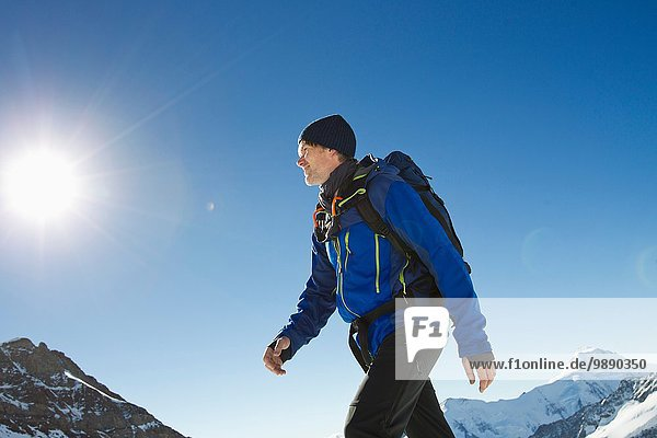 Man hiking in snow covered mountains  Jungfrauchjoch  Grindelwald  Switzerland