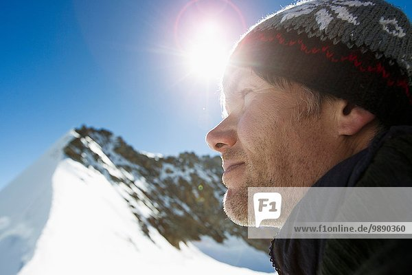 Close up portrait of hiker in snow covered mountains  Jungfrauchjoch  Grindelwald  Switzerland