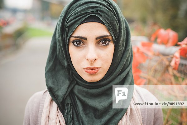 Close up portrait of young woman wearing hijab