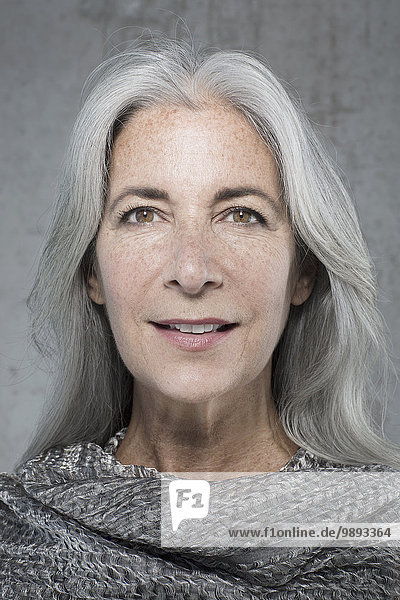 Portrait of beautiful mature woman with long grey hair