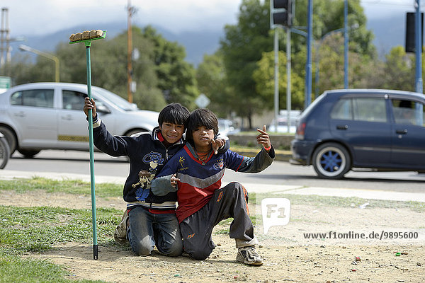 Bolivia  Cochabamba  two street kids with wiper at the roadside