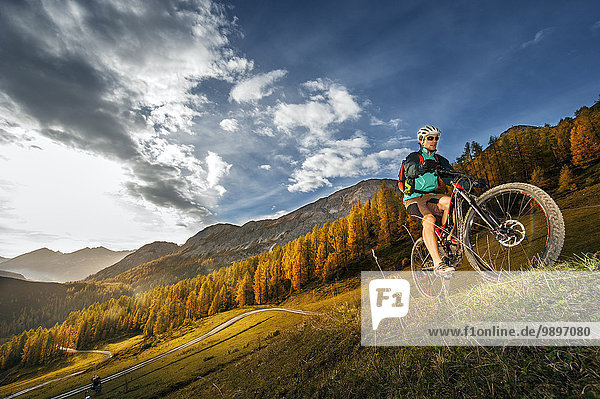 Austria  Altenmarkt-Zauchensee  young mountain biker driving at Low Tauern