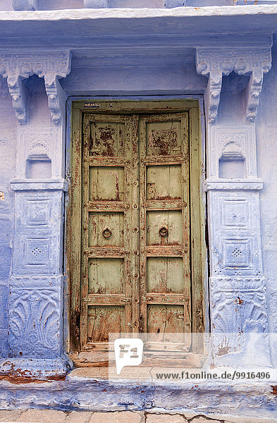 Front door and typical blue facade  Jodhpur  Rajasthan  India  Asia