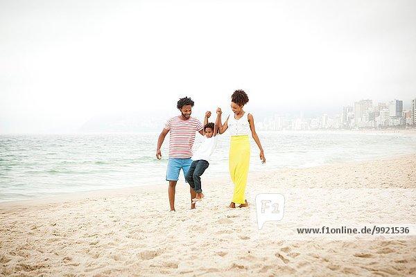 Couple and son enjoying beach  Rio de Janeiro  Brazil