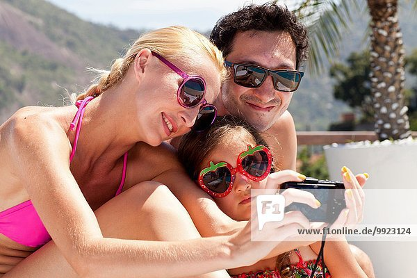 Young family taking self portrait with camera