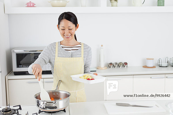 Woman cooking in an open kitchen