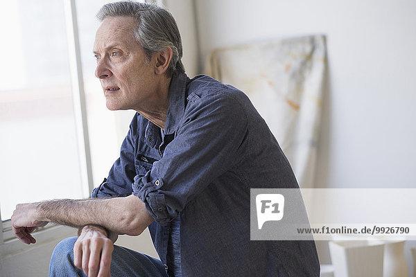 Portrait of senior man indoors