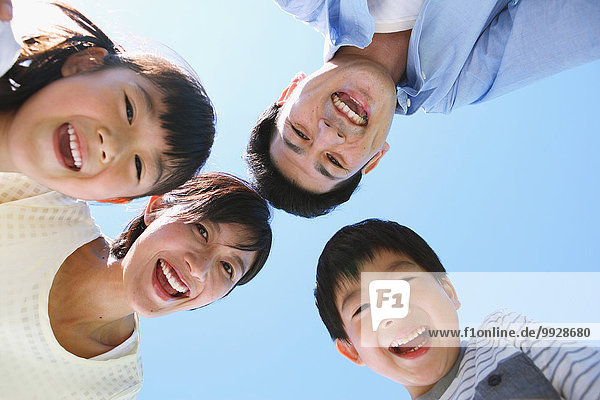 Happy Japanese family smiling