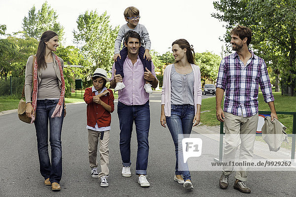 Family walking together in street