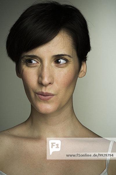 Mid-adult woman glancing sideways  portrait
