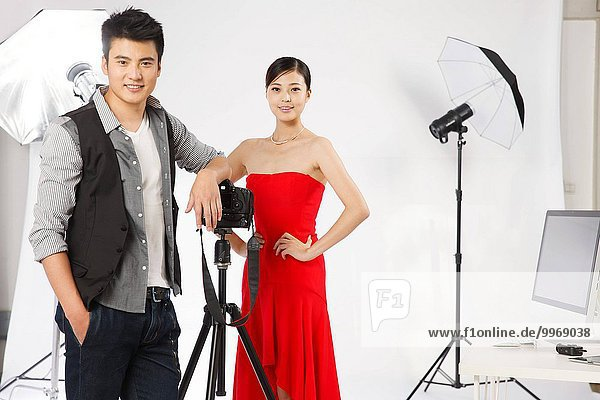 The photographer and actors in the studio