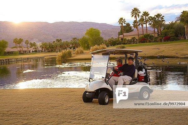 Mann fahren Fuhrwerk 2 Golfsport Golf