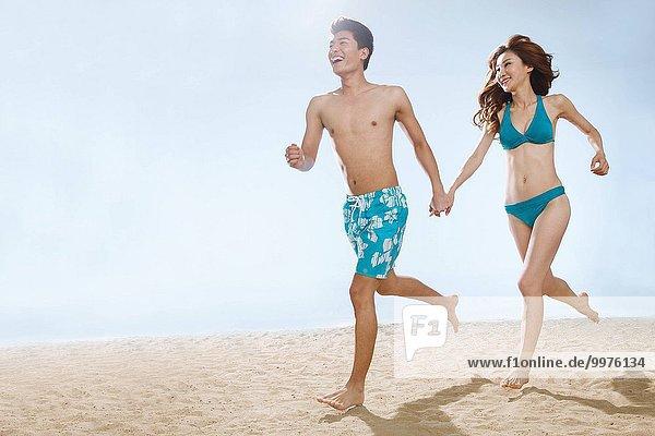 Strand rennen halten Romantik