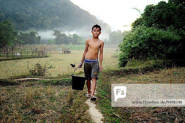 Working boy in Vang Vieng. Laos