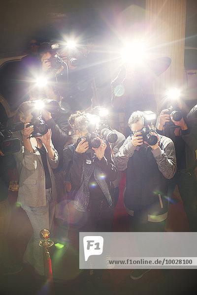 Streulichtblitz von Paparazzi-Fotografen-Kameras
