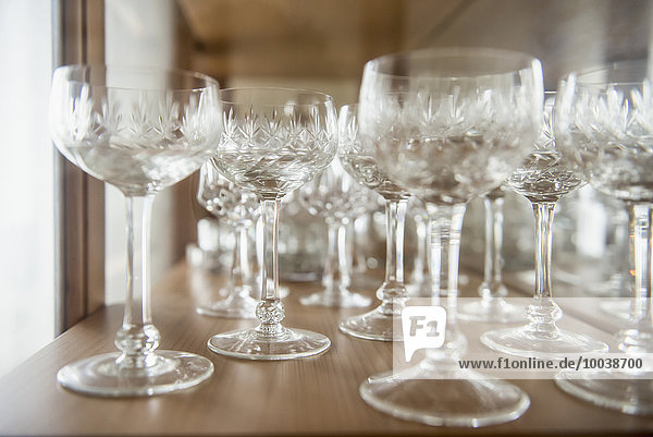 Crystal glasses arranging on a table  Bavaria  Germany Crystal glasses arranging on a table, Bavaria, Germany