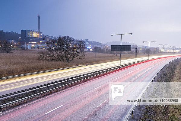 Car lights on road at dusk