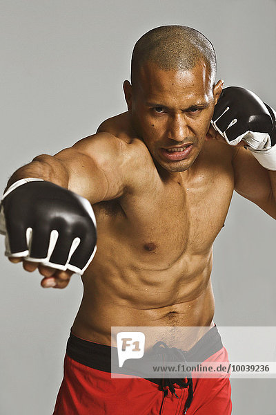 Bald male athlete in a fighting pose