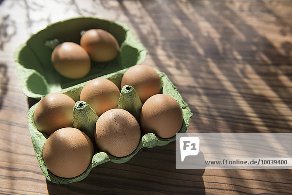 Close-up of eggs tray on table  Munich  Bavaria  Germany