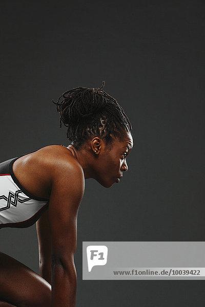 African Woman Runner Preparing To Start