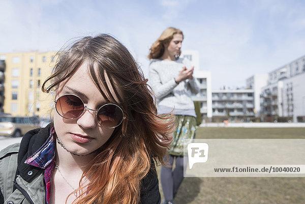 Young woman wearing sunglasses  Munich  Bavaria  Germany