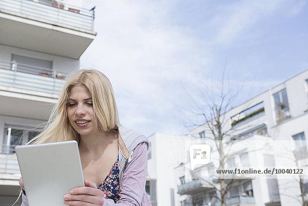 Teenage girl using a digital tablet  Munich  Bavaria  Germany Teenage girl using a digital tablet, Munich, Bavaria, Germany