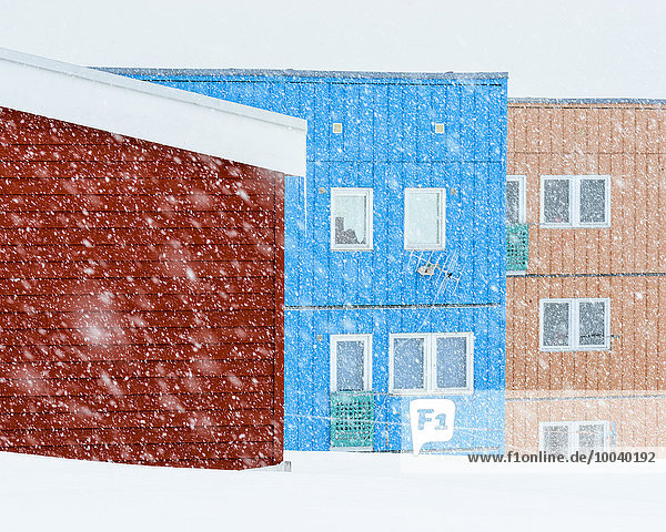 Colorful houses in snowy weather