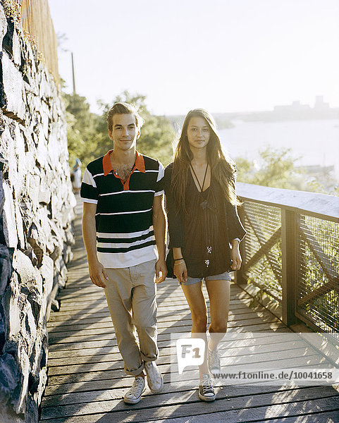 Young couple walking in Stockholm.