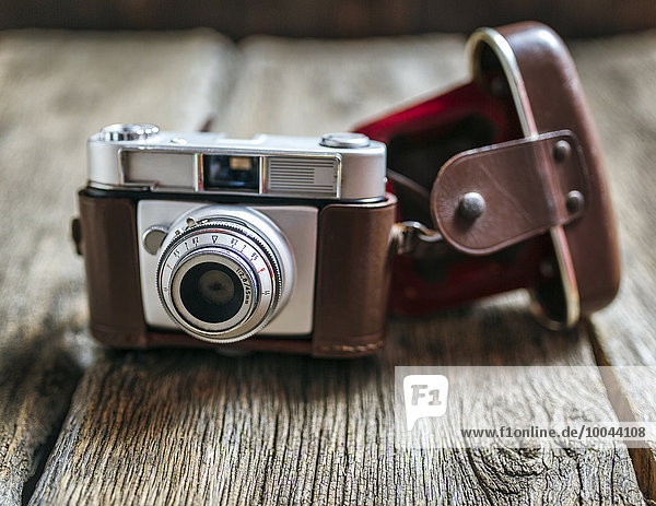 Antique camera on old wood