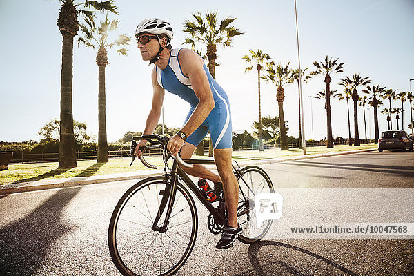 Spanien  Mallorca  Sa Coma  Triathlet-Training auf dem Fahrrad