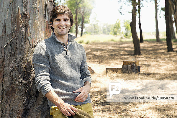 South Africa  portrait of smiling man at a tree