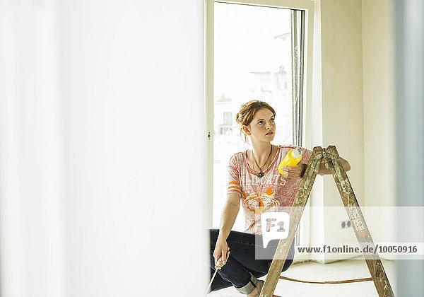 Young woman renovating
