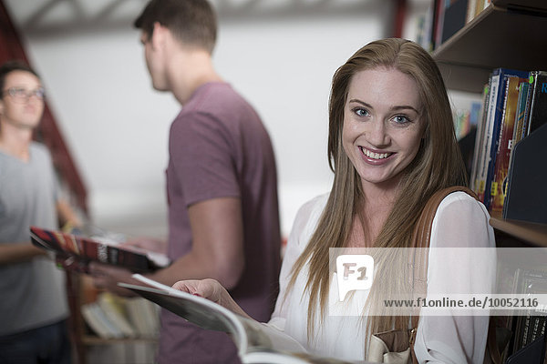 Portrait of smiling female student in a library
